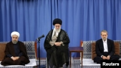(R L) Iran's parliament speaker Ali Larijani, Iran's Supreme Leader Ayatollah Ali Khamenei, and Iranian President Hassan Rouhani. File photo