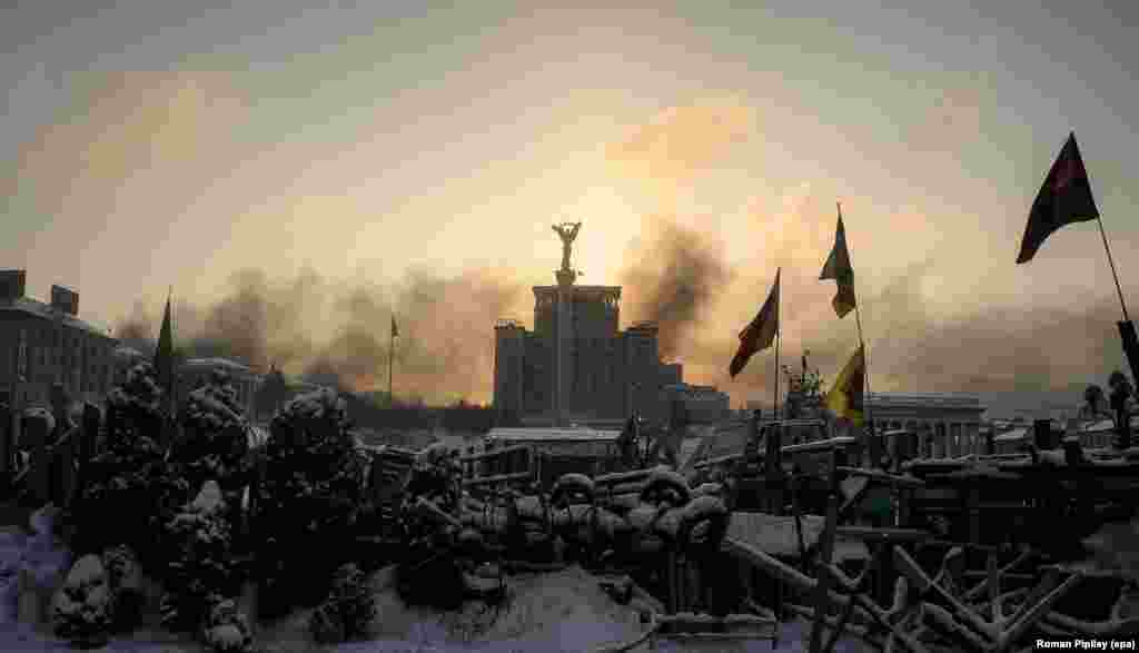 The sun rises over a barricade on Independence Square.
