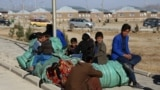 People displaced by fighting rest after fleeing from Jaghori district of the southeastern Ghazni province to escape ongoing battles between Taliban and Afghan security forces on November 15.