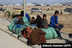 Internally displaced Afghans rest in Ghazni on November 15 after fleeing from the Jaghori district to escape ongoing battles between Taliban and Afghan security forces.