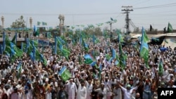 Thousands of Pakistanis turned out to protest the reopening of U.S. supply routes to Afghanistan