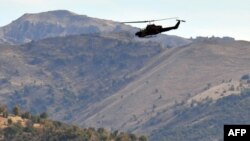 Turkey -- A Turkish military helicopter flies over a mountain in Yemisli, Hakkari province near the Iraqi border, 22Oct2011