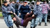 Police detain opposition supporters during a protest calling for free and fair elections during the presidential election in Nur-Sultan, Kazakhstan, in June 2019.