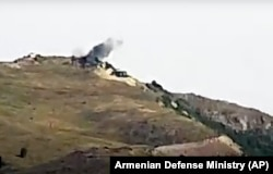 A video grab shows smoke from purported shelling by Armenian forces in the Tovuz region of Azerbaijan on July 14.