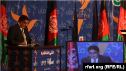 RFE/RL's Akbar Ayazi asking question during the February 15 presidential debate jointly sponsored by RFE/RL and RTA.