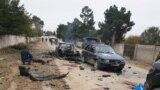 Police investigators work at the site of the attack on the Tajik-Uzbek border.