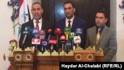 أعضاء في مجلس محافظة بابل يتحدثون في مؤتمر صحفي