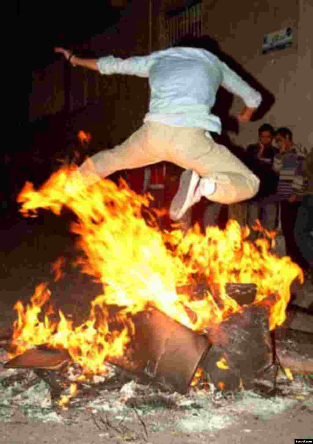An Iranian boy jumps over a fire in an ancient festival called Chaharshanbe Suri (Wednesday Fire) on the last Wednesday prior to Norouz - http://www.kosoof.com/photo/00080-09-4shanbe-soori.jpg Noruz08