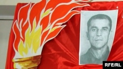 Фотография Мусы Мамута на выставке в Симферополе, посвященной акту его самосожжения