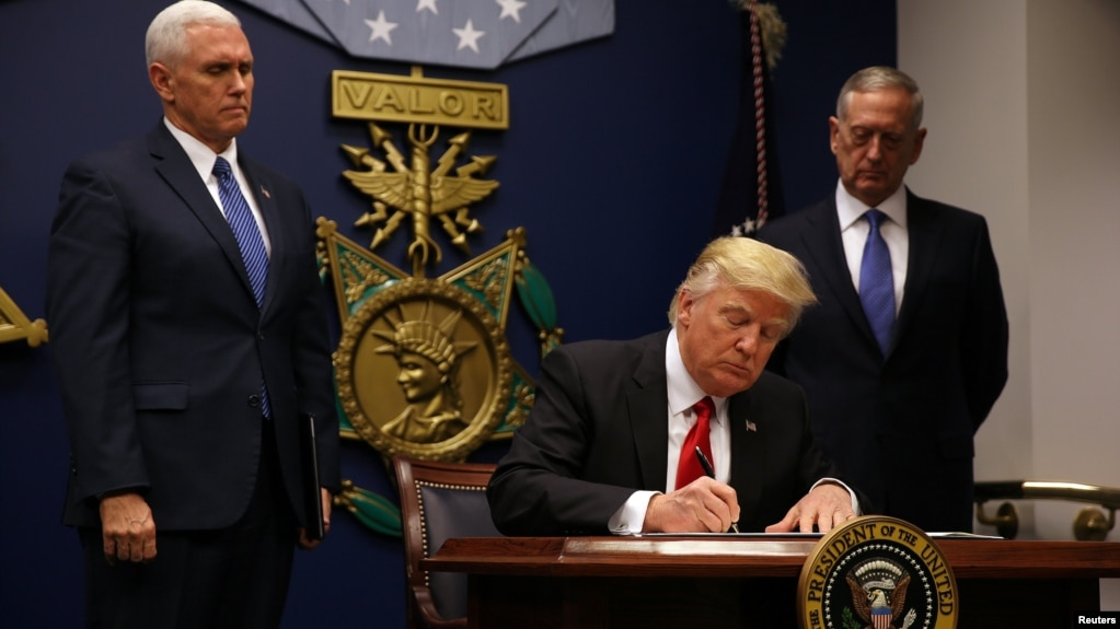 U.S. President Donald Trump signing the executive order on immigration at the Pentagon on January 27.