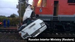 The wreckage of a passenger bus is seen after it was hit by a train at a crossing near the town of Pokrov, in Russia's Vladimir region, on October 6.