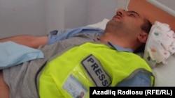 Azerbaijani journalist Idrak Abbasov in a Baku hospital in April 2012.