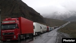 Georgia - Armenian heavy trucks are lined up on a road leading to the Georgian-Russian border crossing at Upper Lars, 6May2016.
