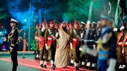 Saudi Arabia's Crown Prince Muhammad bin Salman (center) reviews a Pakistani guard of honor during a welcoming ceremony in Islamabad on February 17.