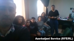 Staff from RFE/RL's Azerbaijani Service are held in their Baku offices on December 26 by state prosecutors who say they have a court order to close the bureau down.