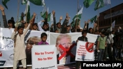 Supporters of Pakistani religious groups rally to condemn a tweet by U.S. President Donald Trump in Karachi on January 2.