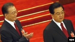 Prime Minister Wen Jiabao (left) with President Hu Jintao at the National People's Congress in Beijing