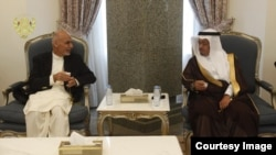 Afghan President Ashraf Ghani (left) meets with a Saudi official in Riyadh on October 25.