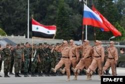 Репетиция российского парада в День Победы на авиабазе Хмеймим в Сирии. 4 мая 2016 года