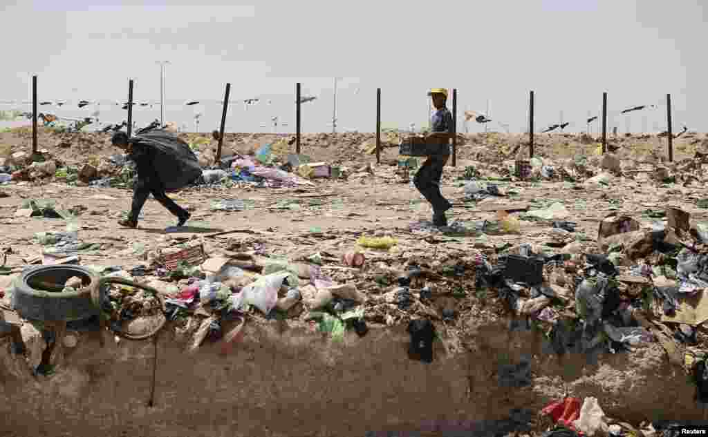 Garbage collectors work at a dump site in Najaf, Iraq. (Reuters/Ahmed Mousa)