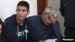 Armenia - Opposition activist Shant Harutiunian (R) and his son Shahen stand trial in Yerevan, 15Oct2014.