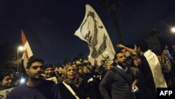 Egyptian opposition supporters shout slogans during a march heading to the presidential palace in Cairo on December 11 to protest against the upcoming referendum on the new draft constitution.