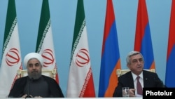 Armenia - President Serzh Sarkisian (R) and his Iranian counterpart Hassan Rouhani address the press after talks in Yerevan, 21Dec2016.