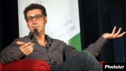 Armenia -- U.S.-Armenian rock singer Serj Tankian speaks at a meeting with civic activists in Yerevan. 15Aug2011.