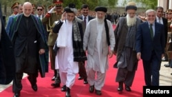 FILE: (L-R) Former Afghan President Hamid Karzai, Afghan President Ashraf Ghani, Afghan warlord Gulbuddin Hekmatyar, Afghan former Jihadi leader Abdul Rabb Rasul Sayyaf and Afghanistan Chief Executive Abdullah Abdullah walking to attend a ceremony.