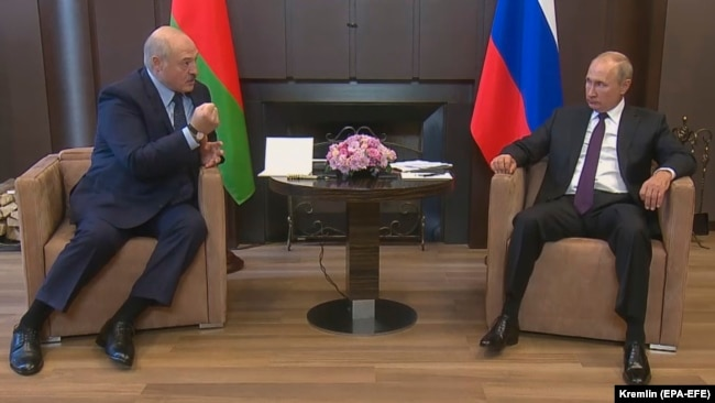 Belarusian President Alyaksandr Lukashenka meets with Russian President Vladimir Putin in the Black Sea resort of Sochi on September 14.