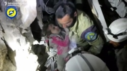 Rescuers Pull Girl From Rubble In Bombed-Out Aleppo