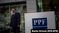 A security officer stands guard outside PPF Group's headquarters in Prague.