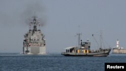 "The Russian amphibious landing vessel ""Caesar Kunikov"" (left) leaves the Black Sea port of Sevastopol in 2012."