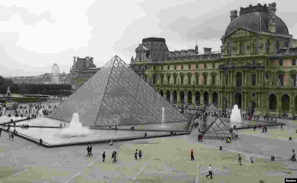 The Louvre Pyramid in Paris was designed by architect I.M. Pei and opened to the public in 1989. At the time, the design of the modern glass pyramid -- set smack dab amid the classical lines of the old Louvre building -- upset many critics and members of the public. It has ultimately become a tourist attraction in its own right and one of the must-sees for visitors to Paris now.