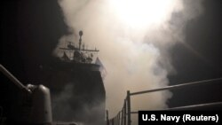 SYRIA – The guided-missile cruiser USS Monterey fires Tomahawk land attack missiles