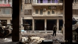 Razrušene zgrade u Aleppu