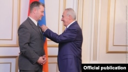 Galust Sahakian (right), speaker of Armenia's parliament, awards the National Assembly's Medal of Honor to Albert Weiler, member of German Bundestag, in Yerevan in August 2016.