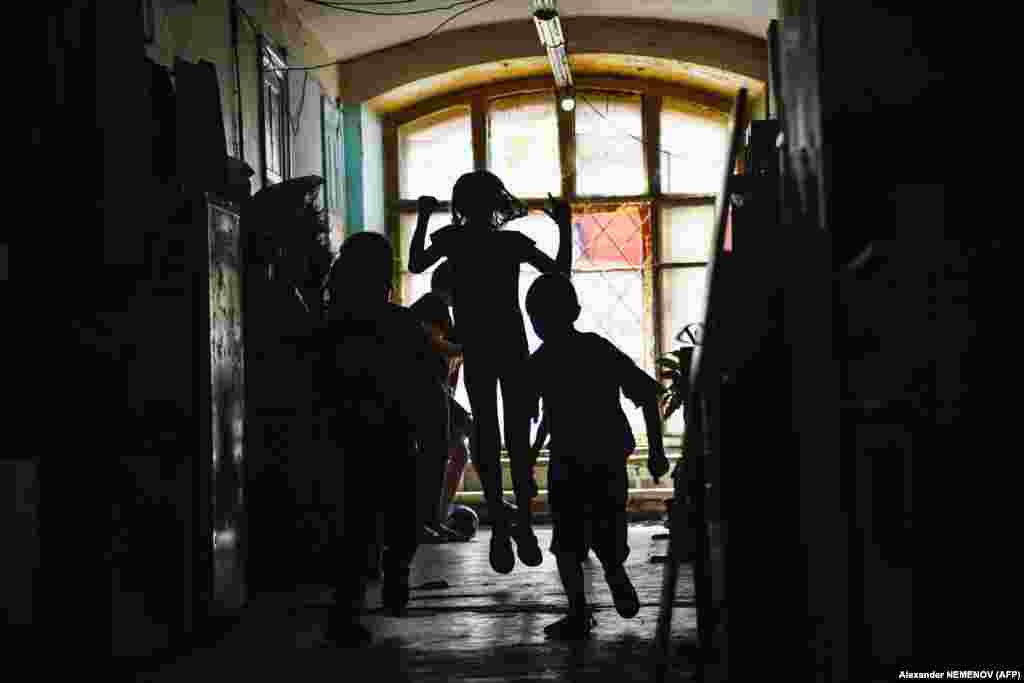 Children play in a dormitory of the Proletarka textile factory. Official statistics are patchy, but according to Housing Ministry figures reported by the newspaper Vedomosti, a third of Russia's housing will need major repairs by 2045.