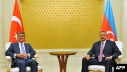Azerbaijani President Ilham Aliyev (right) meets with his Turkish counterpart, Abdullah Gul, in Baku on August 16.