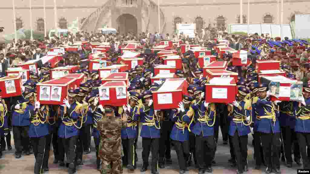 Yemeni soldiers carry coffins on May 24 during the funeral of dozens of troops killed in a suicide bombing in Sanaa three days earlier.  (Reuters)