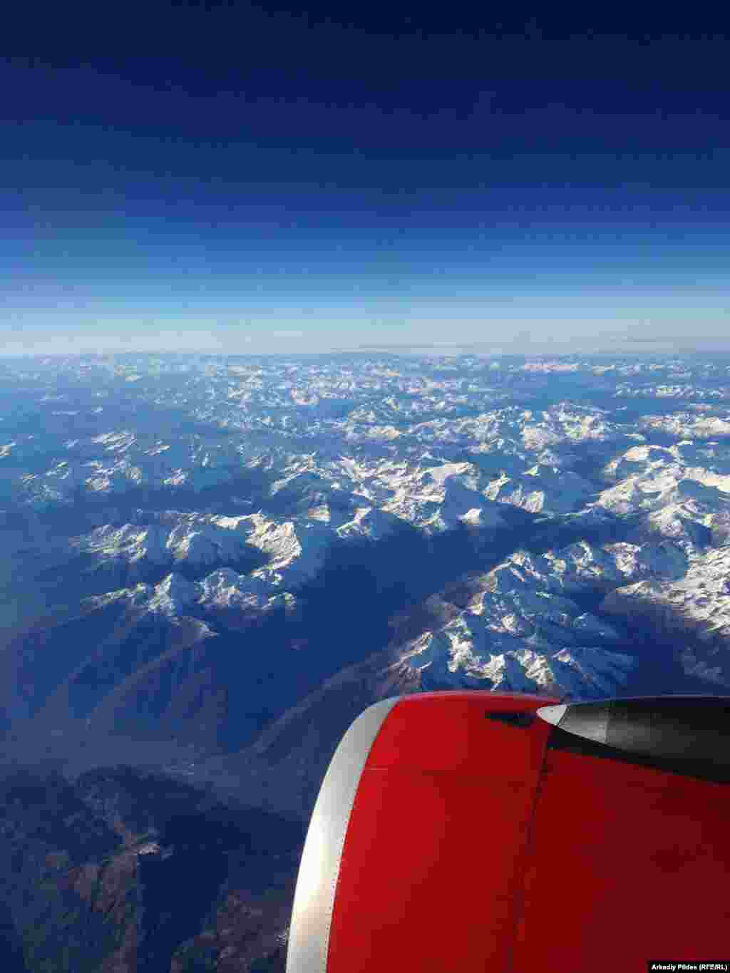 "FINALIST: ""Alps and Airplane"": A view of the Alps on a sunny day from an airplane. (Arkadiy Pildes, RFE/RL's Internet Technology Department)"