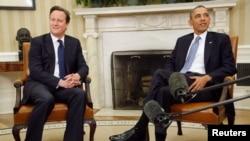 Президент США Барак Обама (справа) и премьер-министр Великобритании Дэвид Кэмерон (слева). Вашингтон, 13 мая 2013 года.