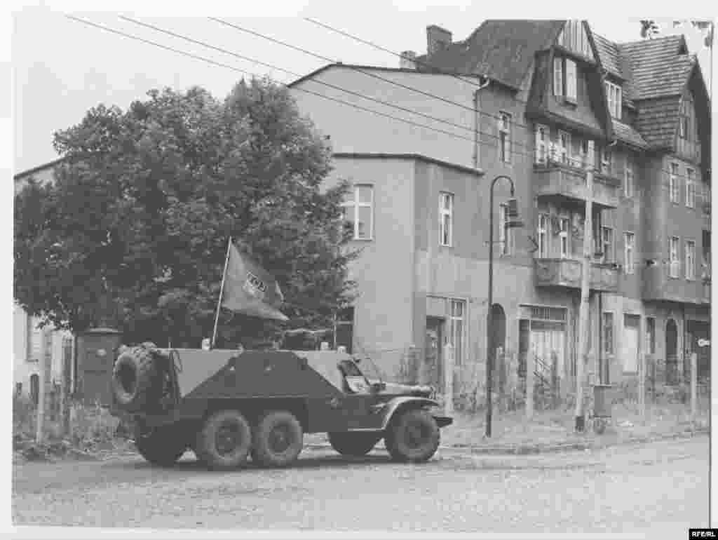 An East German armored car patrols the zonal border between East and West Berlin in mid-August 1961.