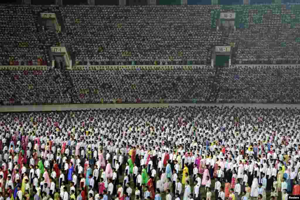 Thousands of North Koreans attend an event to commemorate the 60th anniversary of the signing of a truce in the 1950-53 Korean War at Kim Il Sung Stadium in Pyongyang. (Reuters/Jason Lee)