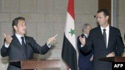 بشار اسد، رییس جمهوری متعهد به کمک برای حل بحران هسته ای ایران شده است. (عکس از AFP)