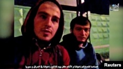 Two Islamic State members in a video claimed responsibility for an attack on a traffic police post outside Moscow.