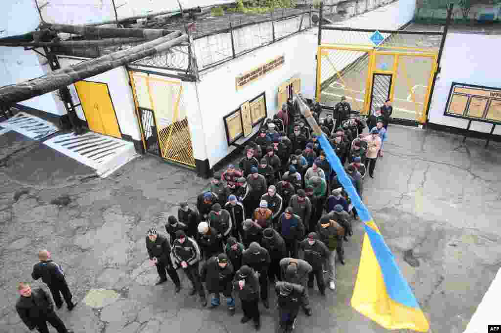 Prisoners march to an internal polling station at a prison in the industrial east Ukrainian city of Makeyevka