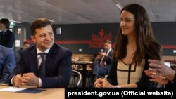 "During a visit to Paris on June 17, Ukrainian President Volodymyr Zelenskiy (left) called beautiful women a Ukrainian ""brand,"" prompting a swift online backlash."