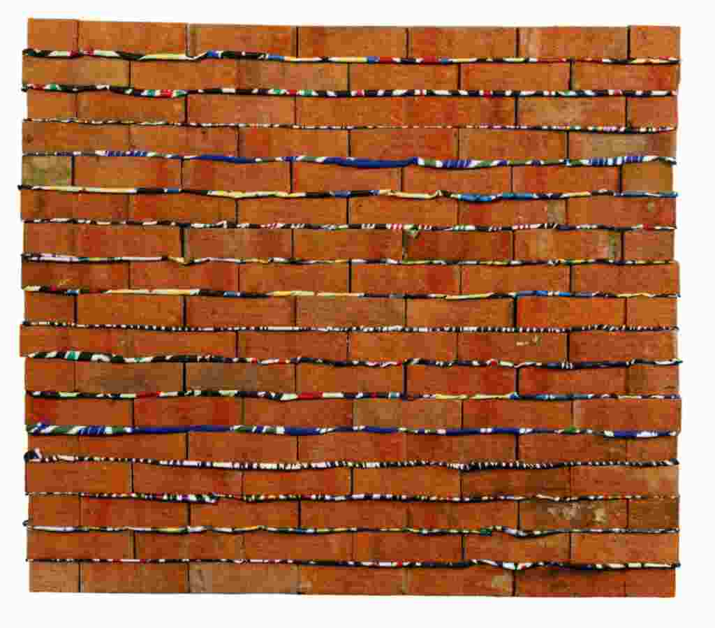 """The Wall,"" a 2009 work by Tajik artist Aleksei Rumyantsev (b. 1975). The piece, composed of real bricks laid over layers of cloth ""mortar,"" is meant to represent the plight of Central Asian labor migrants, many of whom work construction jobs in Russia."