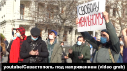 Rally in Sevastopol, January 23, 2021, one of the participants with a poster Freedom to Navalny